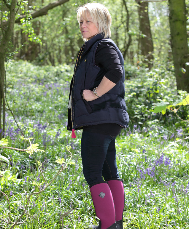 A lady with agricultural boots and country clothing
