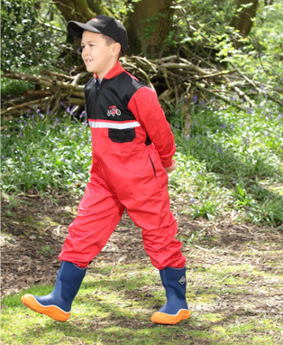 A chirpy boy having a stroll in childrens country clothing
